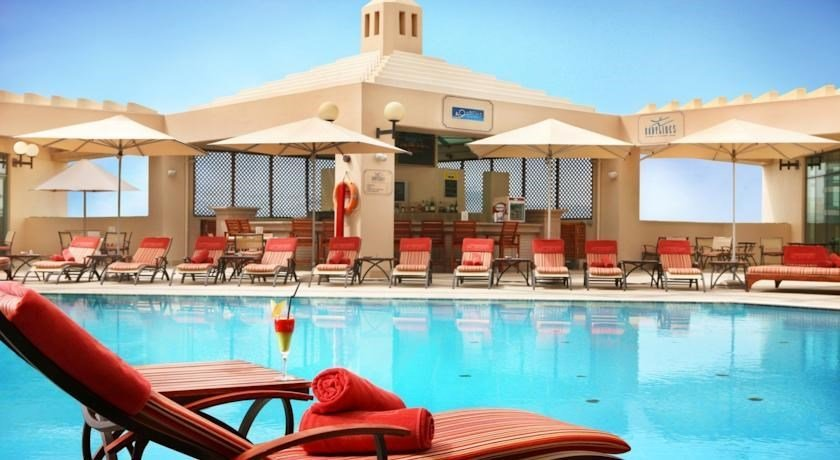 Al Bustan Rotana - Swimming Pool.jpg